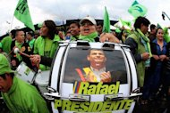 Supporters of Ecuadorian President Rafael Correa celebrate his re-election in Quito on February 17, 2013. Correa&#39;s popular social programs have won him support across the geographically diverse nation