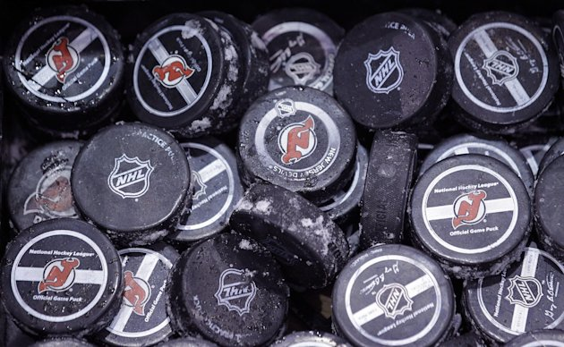 FILE - In this May 15, 2012, file photo, ice covered hockey pucks are shown at the New Jersey Devils practice rink in Newark, N.J. The NHL said Thursday, Oct. 4, 2012, that it has canceled the hockey season through Oct. 24, a total of 82 games, because of the ongoing lockout. The NHL and the players&#39; union are unable to decide how to divide $3 billion in hockey-related revenues. There have been negotiations in recent days, but the sides have not gotten any closer to an agreement on core economic issues.(AP Photo/Julio Cortez, File)