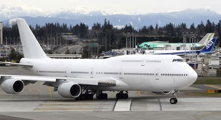 A VIP-configured Boeing 747-8 jetliner rolls out for takeoff from Paine Field in Everett, Washington
