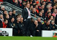 Liverpool's Northern Irish manager Brendan Rodgers (C) looks on during the English Premier League football match between Liverpool and Manchester United at Anfield in Liverpool. Sir Alex Ferguson and Rodgers hope the Hillsborough tribute before Manchester United's 2-1 win over Liverpool at Anfield will end vile chants by both sets of fans