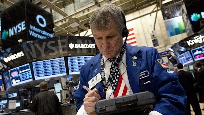 Trader Richard Newman works on the floor of the New York Stock Exchange Friday, March 8, 2013. Stocks are opening higher on Wall Street after the government reported a burst of hiring last month that sent the unemployment rate to a four-year low. (AP Photo/Richard Drew)