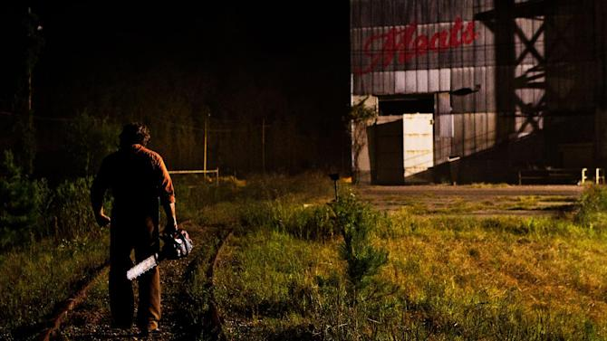 """This undated publicity film image from Lionsgate shows Dan Yeager  starring as Leatherface in a scene from """"Texas Chainsaw 3-D,"""" releasing in theaters on Friday, January 4, 2013.  (AP Photo/Lionsgate, Justin Lubin)"""