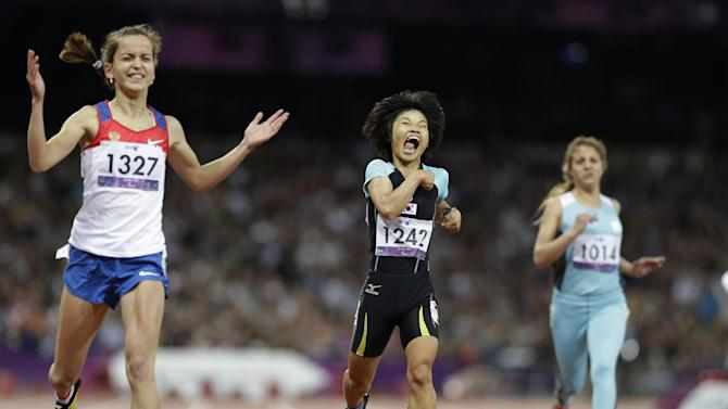 South Korea's Jeon Min Jae, center, celebrates after finishing second at the women's 200m T36 final race at the 2012 Paralympics in London, Saturday, Sept. 1, 2012. Russia's Elena Ivanova, left, won the final. (AP Photo/Lefteris Pitarakis)