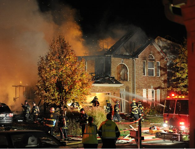 Firefighters work the scene where an explosion has killed two people and damaged more than a dozen homes in the Richmond Hill subdivision, late Saturday, Nov. 10, 2012, in Indianapolis. (AP Photo/The