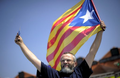 &lt;p&gt;A man holds a Catalan independentist flag during a potest by the No Vull Pagar (I don&#39;t want to pay) movement during a toll road demonstration in July 2012 in Mollet del Valles near Barcelona. Spain&#39;s debt-ridden Catalonia region unveiled plans Friday for a 4.8-billion-euro &quot;Barcelona World&quot; resort but with financing yet to be found and no deal signed.&lt;/p&gt;