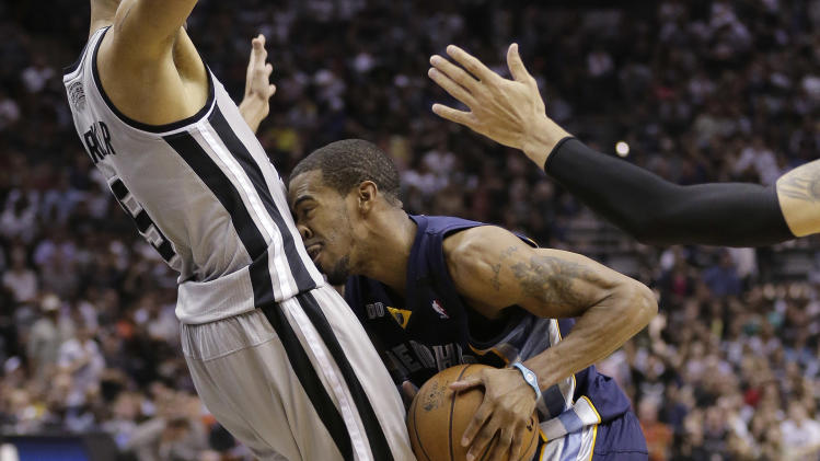 Memphis Grizzlies' Mike Conley, right, crashes into San Antonio Spurs' Tony Parker (9), of France, during the second half in Game 1 of a Western Conference Finals NBA basketball playoff series, Sunday, May 19, 2013, in San Antonio. (AP Photo/Eric Gay)