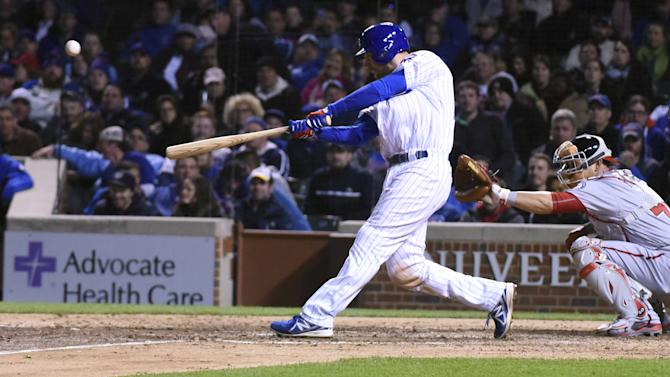 Cubs win again, Encarnacion stars for Blue Jays