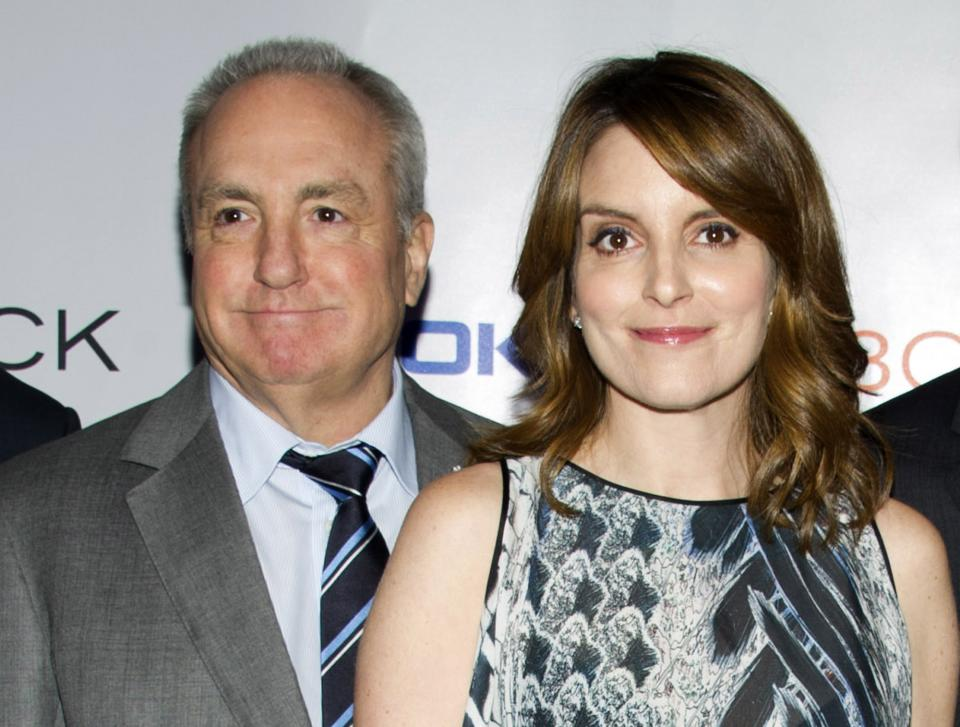 "FILE - In this Dec. 20, 2013 file photo, Lorne Michaels, left, and Tina Fey attend the ""30 Rock"" farewell wrap party in New York. Fey will host the season opener of ""Saturday Night Live,"" on Sept. 28. (Photo by Charles Sykes/Invision/AP, File)"