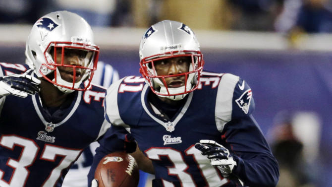 New England Patriots cornerback Alfonzo Dennard (37) watches as cornerback Aqib Talib (31) runs for a touchdown after intercepting a pass off of Indianapolis Colts quarterback Andrew Luck in the second quarter of an NFL football game at Gillette Stadium in Foxborough, Mass., Sunday, Nov. 18, 2012. (AP Photo/Charles Krupa)