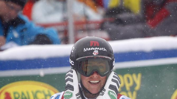 Stacey Cook, of the United States, reacts in the finish area following her run at the the women's World Cup downhill ski race in Lake Louise, Alberta, Friday, Nov. 30, 2012. (AP Photo/The Canadian Press, Jeff McIntosh)