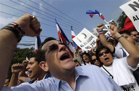 A supporter of Norman Quijano shouts during a protest regarding alleged electoral fraud in San Salvador