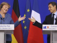 Money woes trouble old allies Merkel, Sarkozy