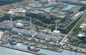 Aerial view of TEPCO's tsunami-crippled Fukushima Daiichi nuclear power plant and its contaminated water storage tanks in Fukushima