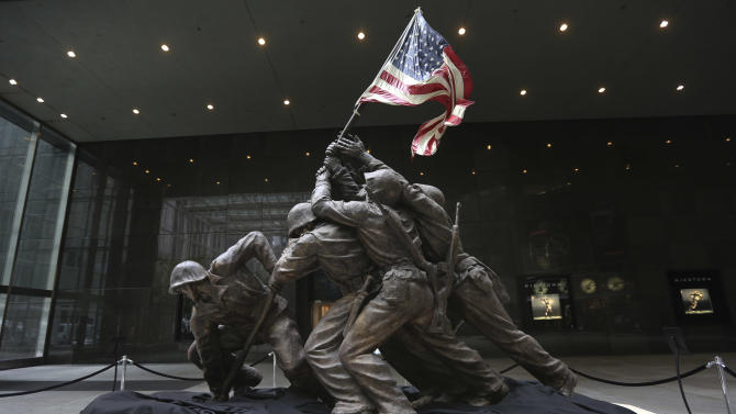 The original 12 1/2-foot (4 meter) cast stone version of Felix de Weldon's iconic statue depicting soldiers raising the U.S. flag at Iwo Jima is on display, Friday, Feb. 22, 2013. The smaller original statue, which was removed in 1947 and hidden under a tarp at the artist's studio for four decades, is expected to fetch up to $1.8 million when it goes on sale at Bonham's auction house in New York on Feb. 22, 2013. (AP Photo/Mary Altaffer)