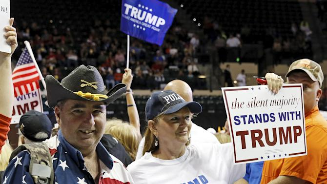 Supporters of U.S. Republican presidential candidate Donald Trump attend a campaign stop in Tampa, Florida