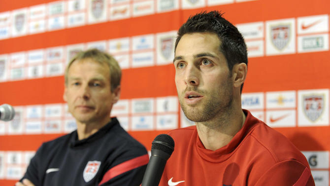 FILE - In this Feb. 28, 2012 file photo, U.S. soccer team defender Carlos Bocanegra answers a question during a press conference prior to a training session ahead of their friendly soccer match against Italy in Genoa, ItalyAt left is U.S. soccer team German coach Jurgen Klinsmann. U.S. captain Bocanegra has been dropped from the roster for World Cup qualifiers against Costa Rica and Mexico. (AP Photo/Tanopress, File)
