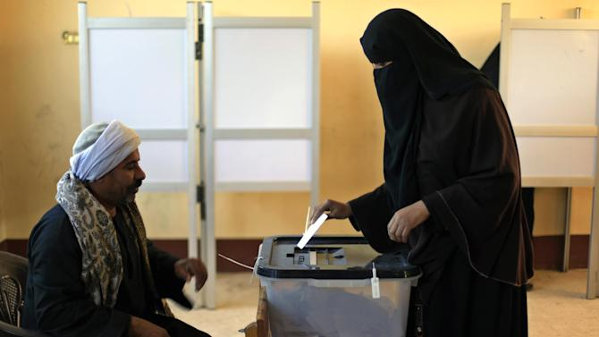 An Egyptian woman casts her vote during the second round of a referendum on a disputed constitution drafted by Islamist supporters of President Mohammed Morsi in Fayoum, about 100 kilometers (62 miles) south of Cairo, Egypt, Saturday, Dec. 22, 2012.(AP Photo/Khalil Hamra)