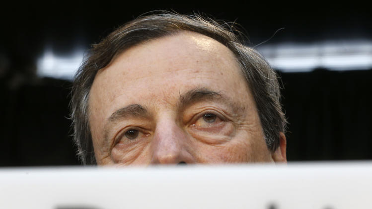 President of European Central Bank Mario Draghi listens to questions during a news conference in Frankfurt, Germany, Thursday, July 4, 2013, following a meeting of the ECB governing council. The ECB decided to leave the key interest rate unchanged. (AP Photo/Michael Probst)