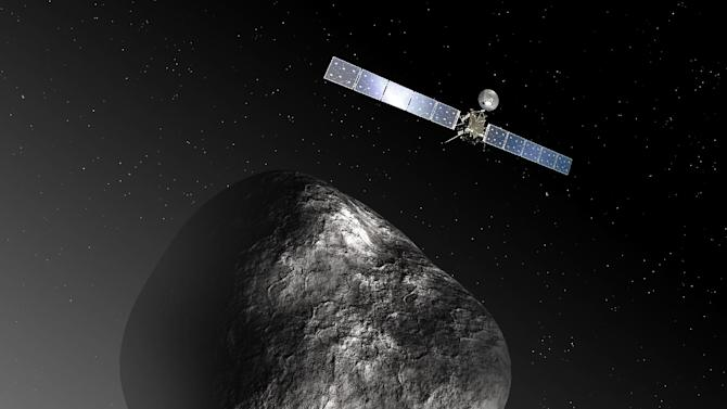 An artist's impression released by the European Space Agency on December 3, 2012 depicts the Rosetta spacecraft orbiting comet 67P/Churyumov–Gerasimenko