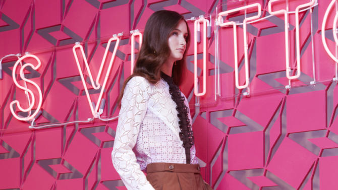 This undated image released by Louis Vuitton shows a model wearing a brown cotton culottes with a tuxedo-style shirt by Louis Vuitton. The Louis Vuitton resort collection harnesses the power of suggestion. There is very little skin shown, yet one just imagines a sultry, confident woman in the layered looks that come with the long silhouette. (AP Photo/Louis Vuitton)
