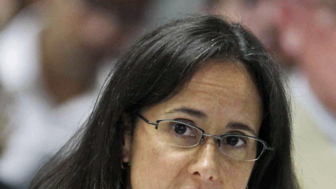 FILE - In this Sept. 10, 2009 file photo, Illinois Attorney Gen. Lisa Madigan speaks in Chicago. Madigan is trying to salvage Illinois' ban on concealed carry. She said Tuesday, Jan. 8, 2013, that she has filed a petition asking that all 15 judges on the U.S. 7th Circuit Court of Appeals review a lawsuit challenging the ban. Last month, a three-judge panel struck down the ban on carrying concealed weapons in Illinois _ the only remaining state where doing so is entirely illegal. (AP Photo/M. Spencer Green, File)