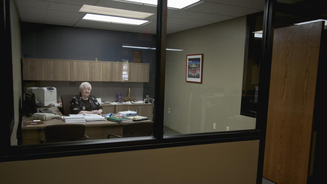 "In this photo taken Aug. 1, 2012, Janice Durflinger poses for a photo at her workplace in Lincoln, Neb. Durflinger, who runs computer software programs for a bank, says she still works at 76, ""because I have to.""  Social Security recipients shouldn't expect a big increase in monthly benefits come January. Preliminary figures show the annual benefit boost will be between 1 percent and 2 percent, which would be among the lowest since automatic adjustments were adopted in 1975. Monthly benefits for retired workers now average $1,237, meaning the typical retiree can expect a raise of between $12 and $24 a month. (AP Photo/Nati Harnik)"