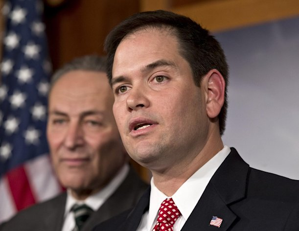 FILE - In this Jan. 28, 2013, photo, Sen. Marco Rubio, R-Fla., right, and Sen. Charles Schumer, D-N.Y., left, join a bipartisan group of leading senators to announce that they have reached agreement on the principles of sweeping legislation to rewrite the nation's immigration laws at the Capitol in Washington. Rubio, a leading proponent of overhauling the immigration system who has gained attention in GOP circles, will deliver the Republican response to President Barack Obama's State of the Union address on Tuesday. (AP Photo/J. Scott Applewhite)