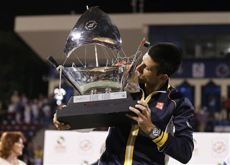 Djokovic kisses the trophy after winning his men's singles final match against Berdych during ATP Dubai Tennis Championships