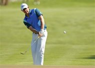 Northern Ireland's McIlroy chips to the 14th green during the second round of the Players Championship PGA golf tournament in Ponte Vedra Beach