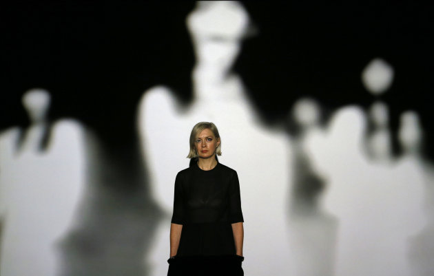Elizabeth Price, the winner of the 2012 Turner Prize, stands with her video installation 'The Woolworths choir of 1979' at the Tate Britain art gallery in London, Monday, Dec. 3, 2012. (AP Photo/Kirsty Wigglesworth)