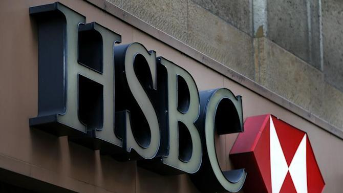 A sign is seen above the entrance to an HSBC branch in midtown Manhattan in New York City