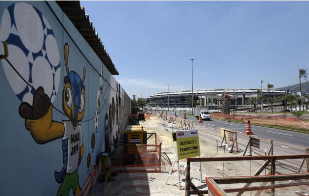 A graffiti art of the official mascot of the FIFA 2014 World Cup, Fuleco the Armadillo is picture next to the Maracana stadium in Rio de Janeiro