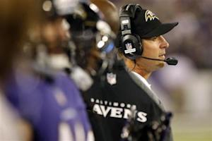 Ravens' Harbaugh watches from the sideline during the first half of their NFL pre-season football game against the Falcons in Baltimore
