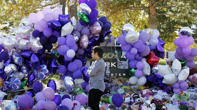 A woman visits a memorial for 10-year-old Jessica Ridgeway at Chelsea Park near the youngster's home in Westminster, Colo., on Monday, Oct. 15, 2012. Jessica Ridgeway was abducted on her way to school on Oct. 5 and found dead in a open space park in Arvada, Colo., on Oct. 10. Police have not made an arrest in the case. (AP Photo/Ed Andrieski)