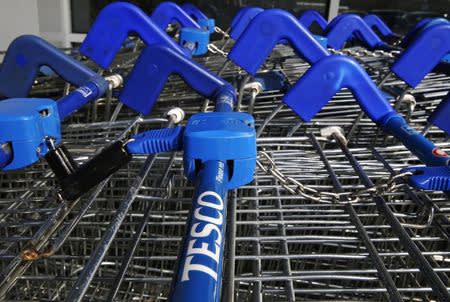 Shopping trolleys are seen at a Tesco Express in southwest London