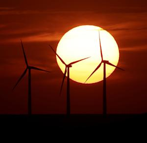 """FILE - This Aug. 23, 2013 file photo shows wind turbines silhouetted by the setting sun near Beaumont, Kansas. The head of the Fish and Wildlife Service tells a House panel he is unable to comply with a request for thousands of documents related to enforcement of environmental laws at wind farms where eagles and other birds have been killed. Agency director Dan Ashe said he and his staff have made """"super-human efforts' to supply the documents, but said the amount of documents being sought and the timeframe were """"completely unreasonable.'' House Republicans say the administration has engaged in a """"deliberate, 10-month-long slow roll"""" to supply documents. An Associated Press investigation last year revealed that the Obama administration was failing to enforce the law for wind power, even as it pursued bird deaths caused by oil companies. (AP Photo/Charlie Riedel, File)"""