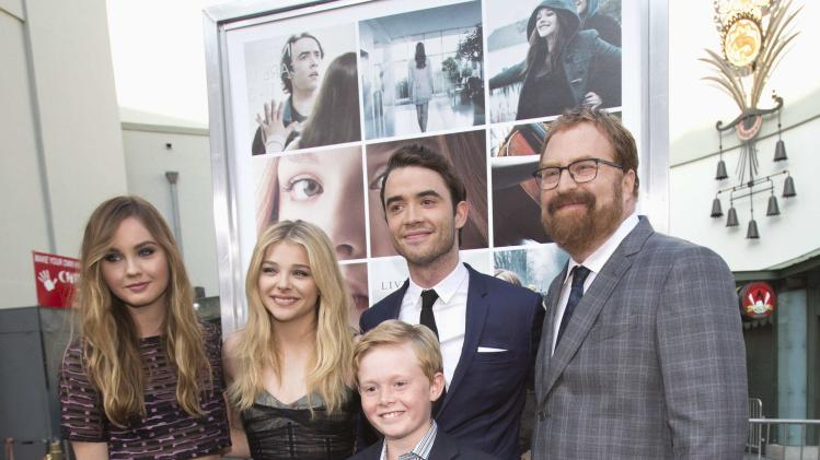 "Director of the movie Cutler poses with cast members Liberato, Moretz, Blackley and Davies at the premiere of ""If I Stay"" in Hollywood"