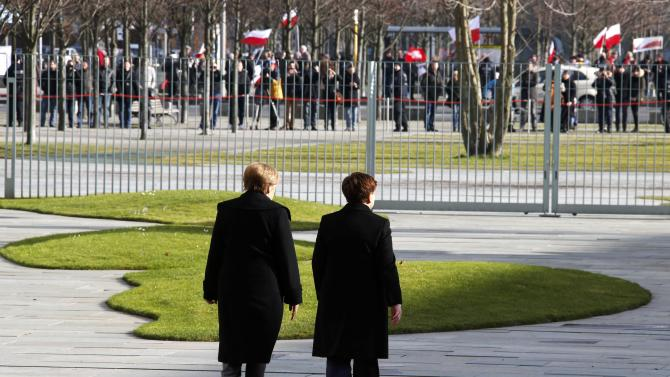 German Chancellor Merkel walks with Polish Prime Minister Szydlo at the Chancellery in Berlin