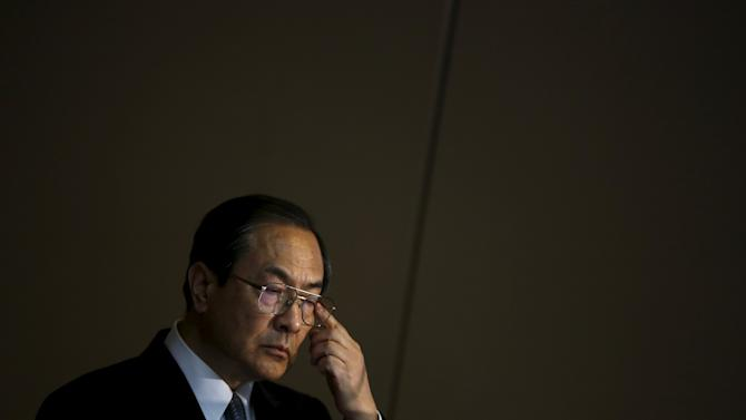 Toshiba Corp President and CEO Masashi Muromachi gestures during news conference in Tokyo