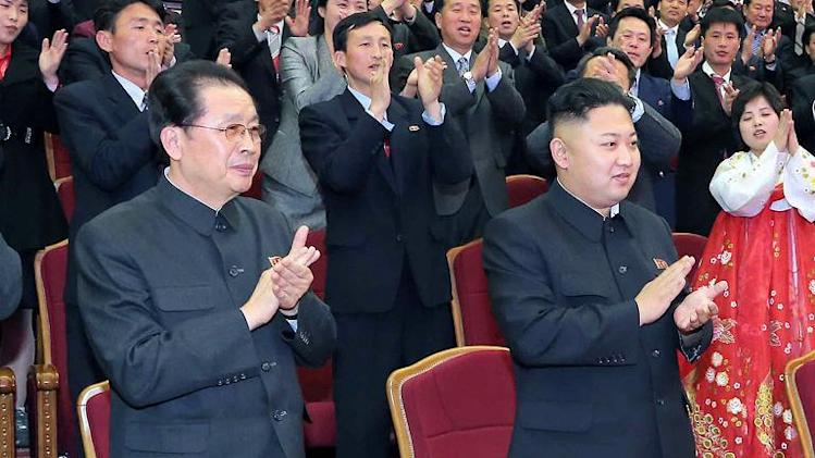 Picture taken by North Korea's official Korean Central News Agency (KCNA) shows Jang Song-Thaek (left) and Kim Jong-Un at the People's Theatre in Pyongyang, on April 15, 2013