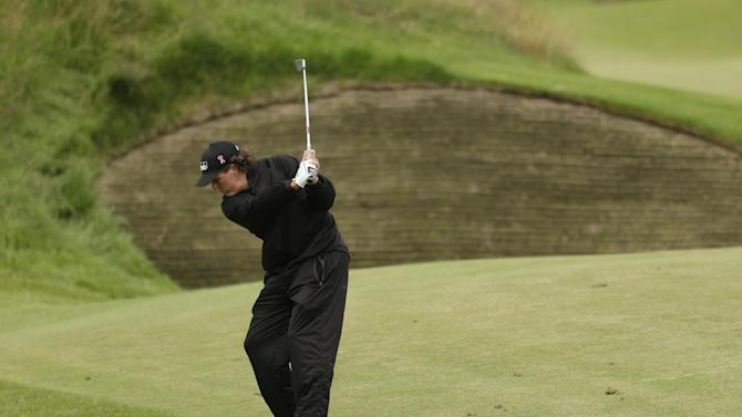 Phil Mickelson of the United States plays a shot on the 10th hole during a practice round at Royal Lytham & St Annes golf club ahead of the British Open Golf Championship, Lytham St Annes, England Tuesday, July  17, 2012. (AP Photo/Peter Morrison)