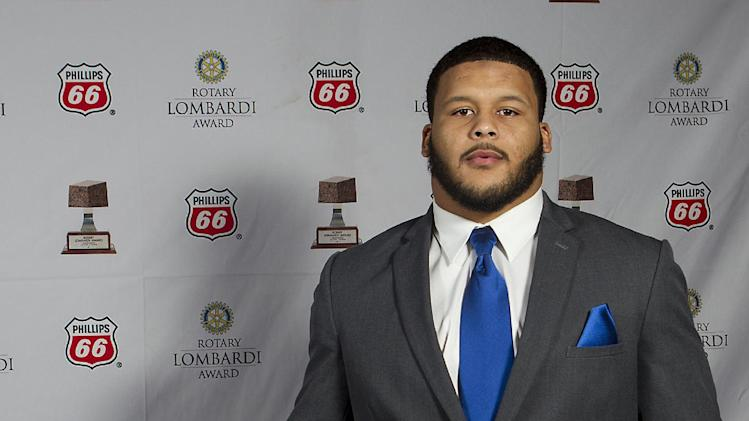 Pittsburgh defensive tackle Aaron Donald poses for a portrait with the Rotary Lombardi Award prior to the awards ceremony on Wednesday, Dec. 11, 2013, in Houston. Donald won the award on Wednesday night