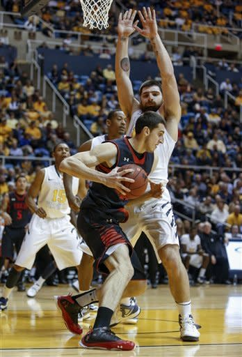 Kilicli helps West Virginia edge Texas Tech 66-64
