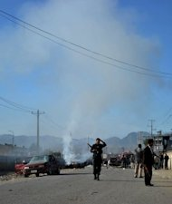 Security personnel gather at the site of a Taliban suicide attack in Kabul. Taliban insurgents claimed the attack, shortly after US President Barack Obama left the city after an overnight visit