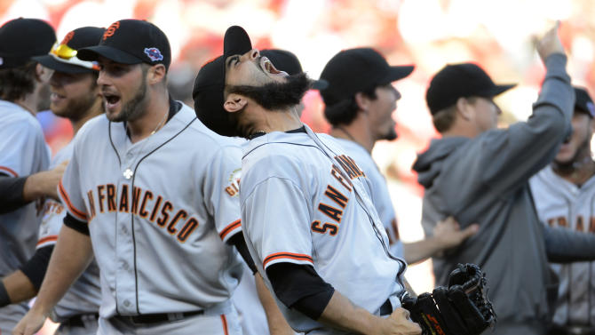 San Francisco Giants relief pitcher Sergio Romo, center, celebrates with teammate after the Giants defeated the Cincinnati Reds 6-4 in Game 5 of the National League division baseball series, Thursday, Oct. 11, 2012, in Cincinnati.  The Giants won the final three games, all in Cincinnati, and advanced to the NL championship series.  (AP Photo/Michael Keating)