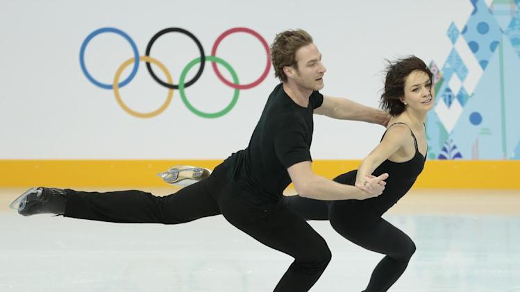 France's Nathalie Pechalat and Fabian Bourzat skate at the figure skating practice rink ahead of the 2014 Winter Olympics, Wednesday, Feb. 5, 2014, in Sochi, Russia. (AP Photo/Ivan Sekretarev)