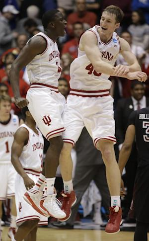 Indiana guard Victor Oladipo (4) and forward Cody Zeller celebrate after they defeated Temple 58-52 in a third-round game of the NCAA college basketball tournament Sunday March 24, 2013, in Dayton, Ohio. (AP Photo/Al Behrman)