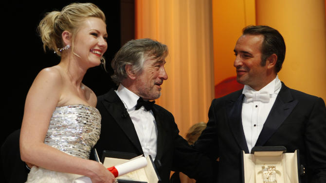 President of the jury Robert De Niro, center, talks with Best Actress recipient Kirsten Dunst, left, and Best Actor recipient Jean Dujardin, right, during the awards ceremony at the 64th international film festival, in Cannes, southern France, Sunday, May 22, 2011. (AP Photo/Lionel Cironneau)