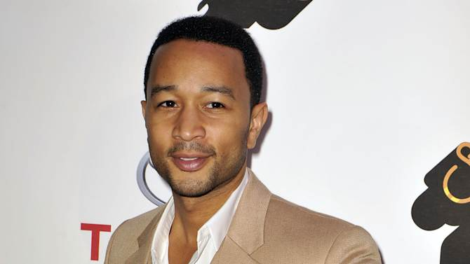FILE - In this Nov. 8, 2012 file photo, singer John Legend arrives at the Soul Train Awards at Planet Hollywood Resort and Casino in Las Vegas. President Obama released an official playlist through the digital music service Spotify on Thursday, Jan. 18, 2013. The list includes songs by Legend, Stevie Wonder, Beyonce, Usher, fun. and other acts set to perform during various inauguration events. (Photo by Jeff Bottari/Invision/AP, file)