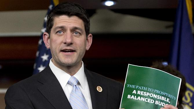 House Budget Committee Chairman Rep. Paul Ryan, R-Wis., holds up a copy of the House Budget Committee 2014 Budget Resolution as he speaks during a news conference on Capitol Hill in Washington, Tuesday, March 12, 2013. (AP Photo/Carolyn Kaster)